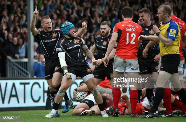 Jack Nowell of Exeter Chiefs celebrates after scoring the opening try during the Aviva Premiership semi final match between Exeter Chiefs and...