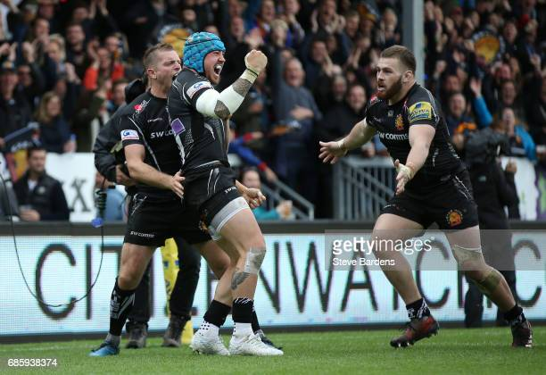 Jack Nowell of Exeter Chiefs celebrates with teammates Gareth Steenson and Luke CowanDickie after scoring the opening try during the Aviva...