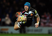 Jack Nowell of Exeter Chiefs dives over for his side's first try during the Aviva Premiership match between Exeter Chiefs and Gloucester Rugby at...