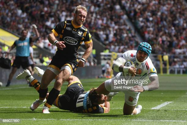 Jack Nowell of Exeter Chiefs dives over to score the first try during the Aviva Premiership match between Wasps and Exeter Chiefs at Twickenham...