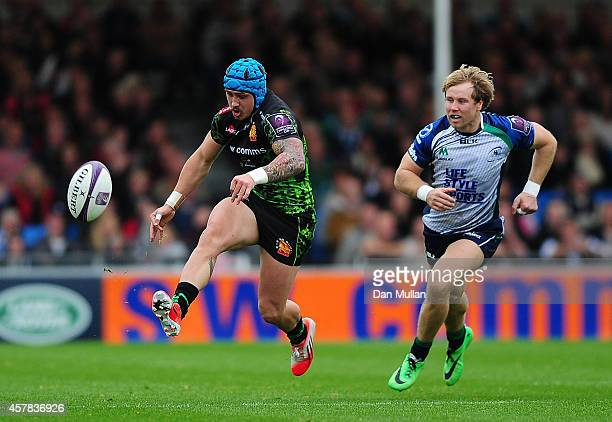 Jack Nowell of Exeter Chiefs kicks away from Fionn Carr of Connacht during the European Rugby Challenge Cup match between Exeter Chiefs and Connacht...