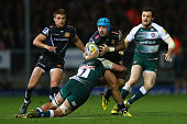 Jack Nowell of Exeter Chiefs looks for support as Lachlan McCaffreey of Leicester Tigers holds on in the tackle during the Aviva Premiership match...