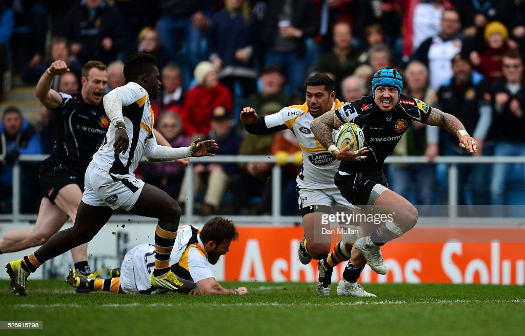 Jack Nowell of Exeter Chiefs runs in to score his side's third try past Christian Wade of Wasps during the Aviva Premiership match between Exeter Chiefs and Wasps at Sandy Park on May 01, 2016 in Exeter, England.