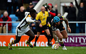 Jack Nowell of Exeter Chiefs scores his side's third try past Christian Wade of Wasps during the Aviva Premiership match between Exeter Chiefs and...