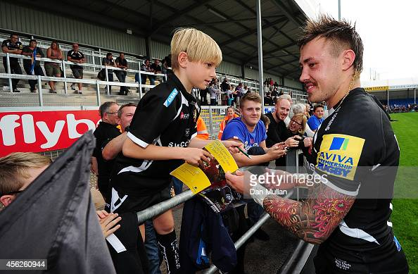 Jack Nowell of Exeter Chiefs signs autographs for young fans following the Aviva Premiership match between Exeter Chiefs and Harlequins at Sandy Park...