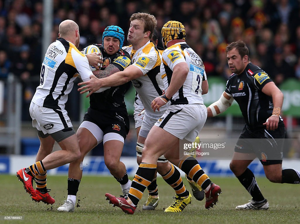 <a gi-track='captionPersonalityLinkClicked' href=/galleries/search?phrase=Jack+Nowell&family=editorial&specificpeople=7377985 ng-click='$event.stopPropagation()'>Jack Nowell</a> of Exeter is tackled by Joe Simpson (L) and <a gi-track='captionPersonalityLinkClicked' href=/galleries/search?phrase=Joe+Launchbury&family=editorial&specificpeople=7440712 ng-click='$event.stopPropagation()'>Joe Launchbury</a> during the Aviva Premiership match between Exeter Chiefs and Wasps at Sandy Park on May 1, 2016 in Exeter, England.