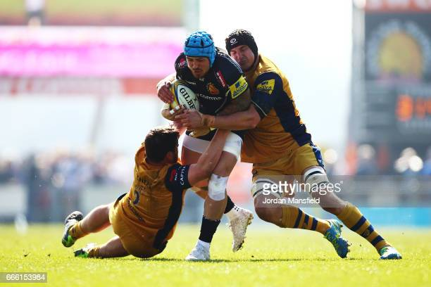 Jack Nowell of Exeter is tackled by Marc Jones and Mark Sorenson of Bristol during the Aviva Premiership match between Exeter Chiefs and Bristol...