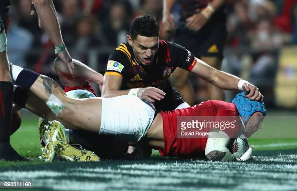 Jack Nowell of the Lions dives over to score his first try during the match between the Chiefs and the British Irish Lions at Waikato Stadium on June...