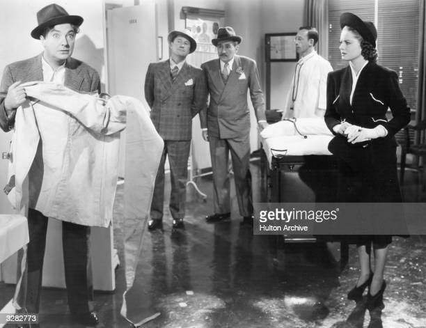 Jack Oakie formerly Lewis D Offield the American comic actor is viewed with Jack Haley the American light comedian and Adolphe Menjou the...