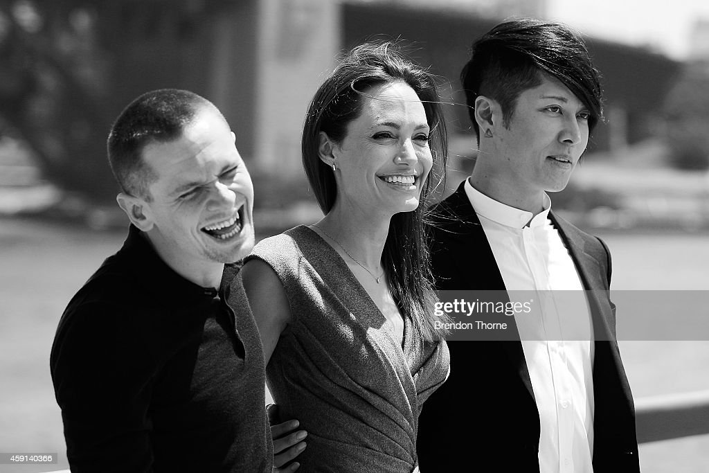 Jack O'Connell, Angelina Jolie and Miyavi Ishihara share a joke at the photo call of Unbroken at Sydney Opera House on November 18, 2014 in Sydney, Australia.