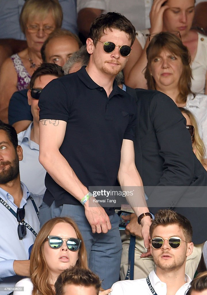 Jack O'Connell attends the Sam Querry v Roger Federer match on day four of the Wimbledon Tennis Championships at Wimbledon on July 2 2015 in London...