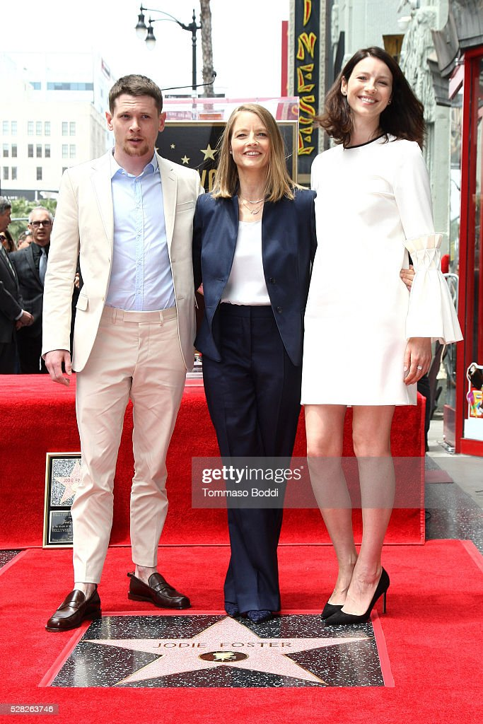 Jack O'Connell, Jodie Foster and Caitriona Balfe attend a ceremony honoring actress Jodie Foster with a star ceremony on The Hollywood Walk Of Fame on May 4, 2016 in Hollywood, California.