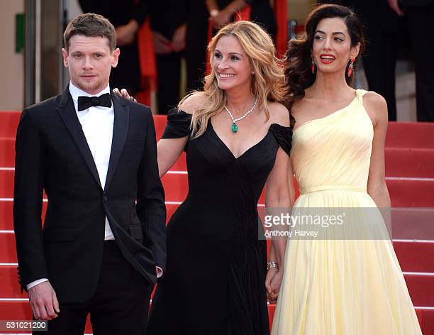 Jack O'Connell Julia Roberts and Amal Clooney attend the 'Money Monster' premiere during the 69th annual Cannes Film Festival at the Palais des...