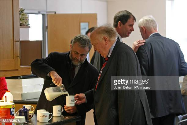 Jack O'Connor of the Services Industrial Professional and Technical Union pours milk for Dan Murphy the General Secretary of the Public Services...