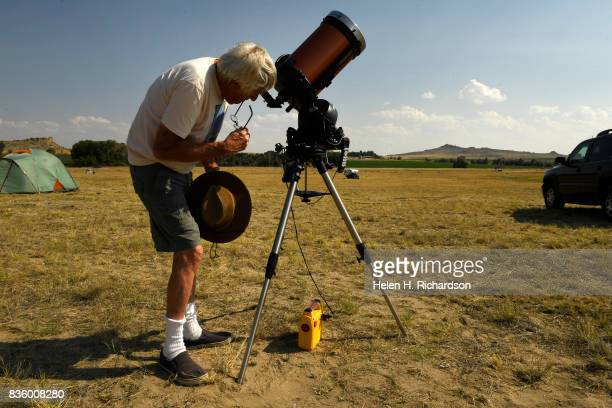 Jack Patzold a hobbyist astronomer looks at sunspots on the sun through his telescope that he has set up to view the eclipse at an RV park on August...