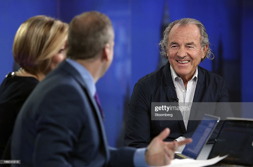 Jack Penrod, founder of Nikki Beach, right, reacts during a Bloomberg Television interview in London, U.K., on Wednesday, May 22, 2013. After years of dipping in backyard pools and exploring neighborhood festivals during so-called summer staycations, Americans may be ready to splurge a bit more this year, giving economic growth and employment a boost. Photographer: Chris Ratcliffe/Bloomberg via Getty Images
