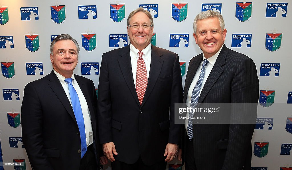 Jack Peters the Chief Operating Officer of the World Golf Hall of Fame (centre) welcomes the new iductees to the World Golf Hall of Fame <a gi-track='captionPersonalityLinkClicked' href=/galleries/search?phrase=Ken+Schofield&family=editorial&specificpeople=226918 ng-click='$event.stopPropagation()'>Ken Schofield</a> of Scotland (L) the former Chief Executive of the European Tour and <a gi-track='captionPersonalityLinkClicked' href=/galleries/search?phrase=Colin+Montgomerie&family=editorial&specificpeople=157549 ng-click='$event.stopPropagation()'>Colin Montgomerie</a> of Scotland (R) during the World Golf Hall of Fame press conference at the European Tour Golfer of the Year lunch at the Royal Lancaster Hotel on December 18, 2012 in London, England.