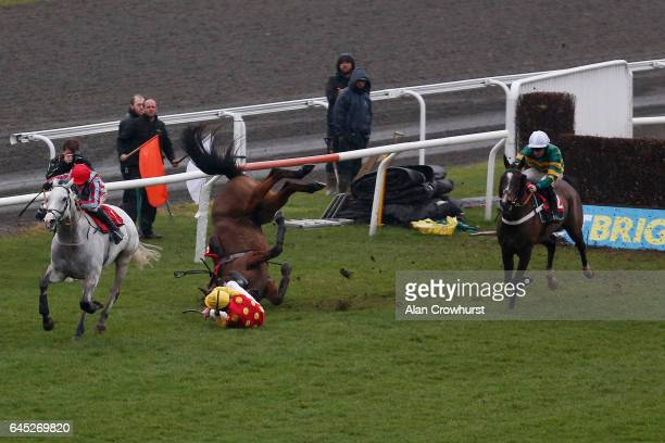 Jack Quinlan riding Sir Note clear the last to win The Watch Live Racing On BetBrightcom Handicap Steeple Chase as William Clarke Falls from Gores...