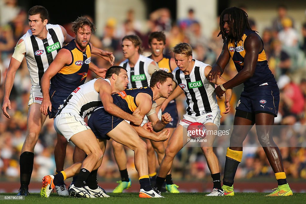 <a gi-track='captionPersonalityLinkClicked' href=/galleries/search?phrase=Jack+Redden&family=editorial&specificpeople=5942332 ng-click='$event.stopPropagation()'>Jack Redden</a> of the Eagles gets his handball away while being tackled by Levi Greenwood of the Magpies during the round six AFL match between the West Coast Eagles and the Collingwood Magpies at Domain Stadium on May 1, 2016 in Perth, Australia.