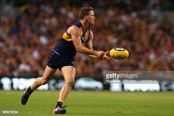 Jack Redden of the Eagles handballs during the round two AFL match between the West Coast Eagles and the St Kilda Saints at Domain Stadium on April 1...