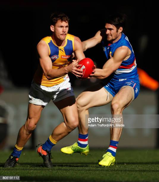 Jack Redden of the Eagles is tackled by Easton Wood of the Bulldogs during the 2017 AFL round 15 match between the Western Bulldogs and the West...