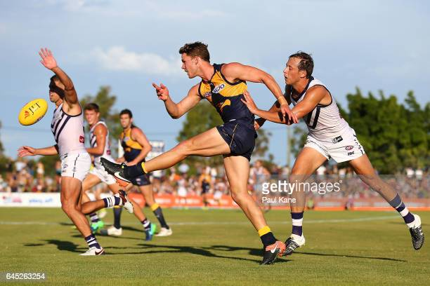 Jack Redden of the Eagles kicks th eball into the forward line during the JLT Community Series AFL match between the West Coast Eagles and the...