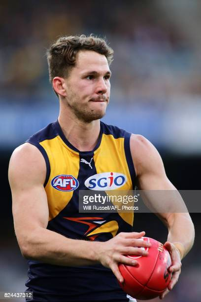 Jack Redden of the Eagles looks to pass the ball during the round 19 AFL match between the West Coast Eagles and the Brisbane Lions at Domain Stadium...
