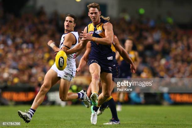 Jack Redden of the Eagles passes the ball during the round six AFL match between the West Coast Eagles and the Fremantle Dockers at Domain Stadium on...