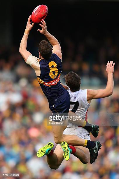 Jack Redden of the Eagles sets for a mark against Jack Viney of the Demons during the round 18 AFL match between the West Coast Eagles and the...