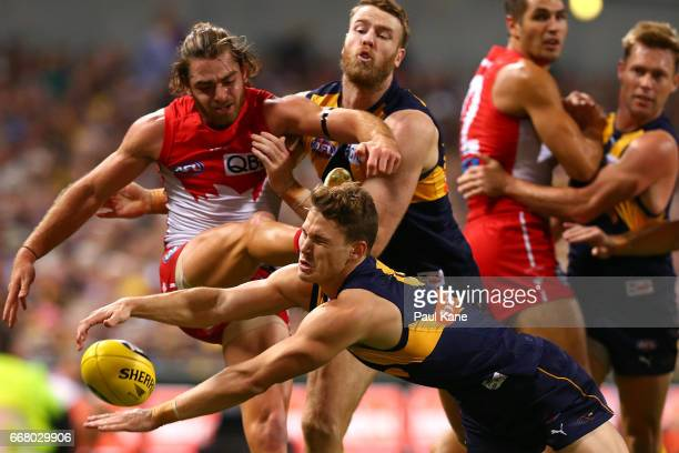 Jack Redden of the Eagles spoils the kick for Jordan Foote of the Swans during the round four AFL match between the West Coast Eagles and the Sydney...