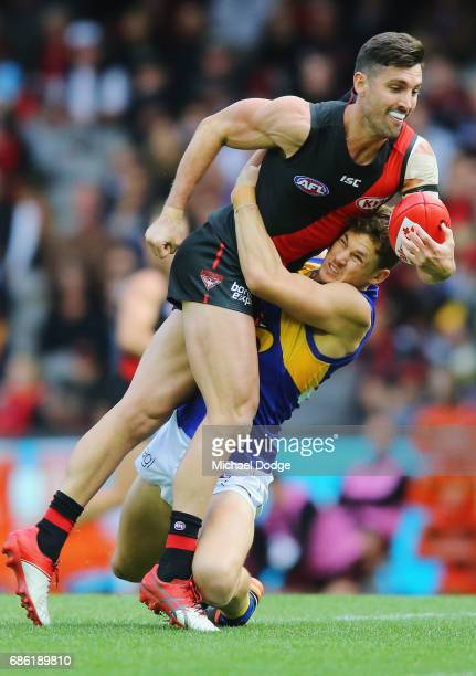 Jack Redden of the Eagles tackles David Myers of the Bombers during the round nine AFL match between the Essendon Bombers and the West Coast Eagles...