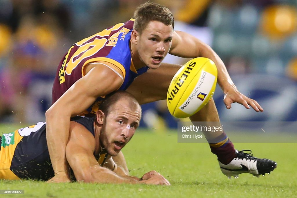 <a gi-track='captionPersonalityLinkClicked' href=/galleries/search?phrase=Jack+Redden&family=editorial&specificpeople=5942332 ng-click='$event.stopPropagation()'>Jack Redden</a> of the Lions tackles Matt Thomas of the Tigers during the round five AFL match between the Brisbane Lions and the Richmond Tigers at The Gabba on April 17, 2014 in Brisbane, Australia.