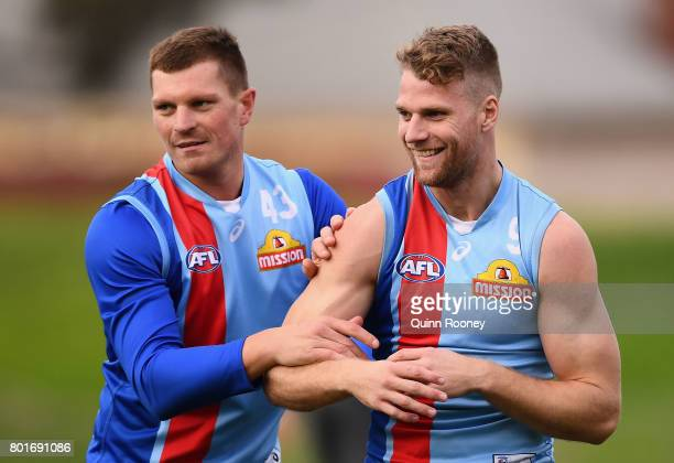 Jack Redpath and Jake Stringer of the Bulldogs prepare to mark during a Western Bulldogs AFL training session at Whitten Oval on June 27 2017 in...