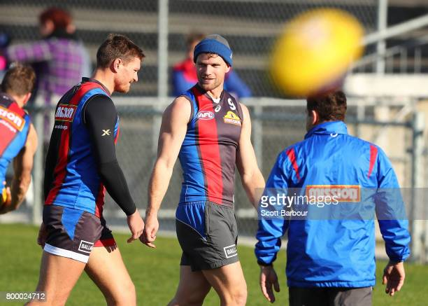 Jack Redpath of the Bulldogs and Jake Stringer of the Bulldogs talk during a Western Bulldogs AFL training session at Whitten Oval on June 23 2017 in...