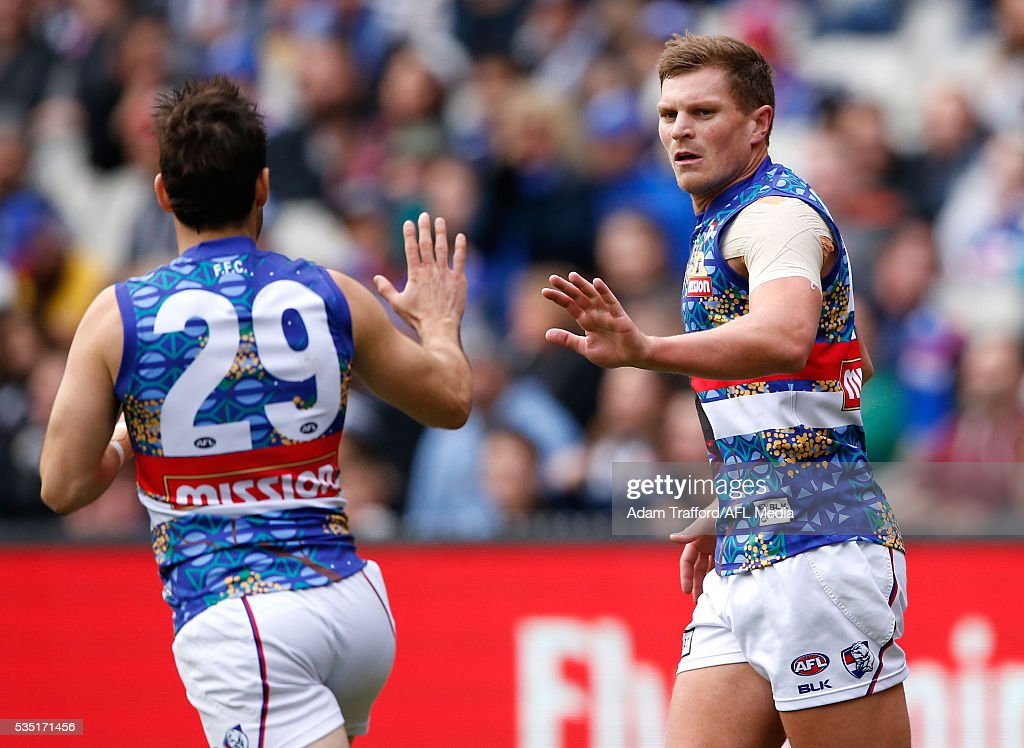 Jack Redpath of the Bulldogs celebrates a goal during the 2016 AFL Round 10 match between the Collingwood Magpies and the Western Bulldogs at the Melbourne Cricket Ground on May 29, 2016 in Melbourne, Australia.