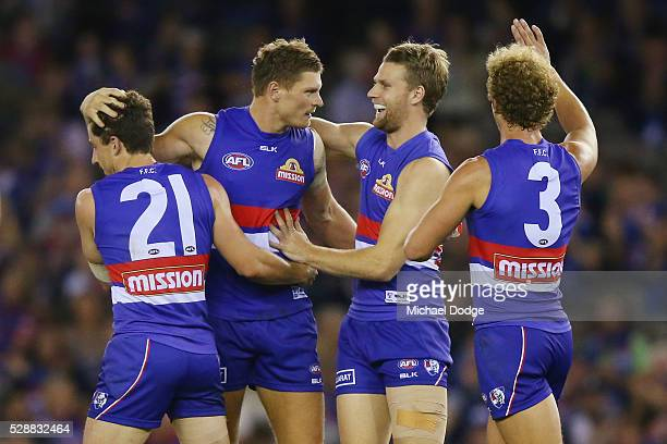 Jack Redpath of the Bulldogs celebrates a goal with Tom Liberatore Jake Stringer and Mitch Wallis during the round seven AFL match between the...