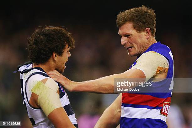Jack Redpath of the Bulldogs grabs Steven Motlop of the Cats by the throat during the round 13 AFL match between the Western Bulldogs and the Geelong...
