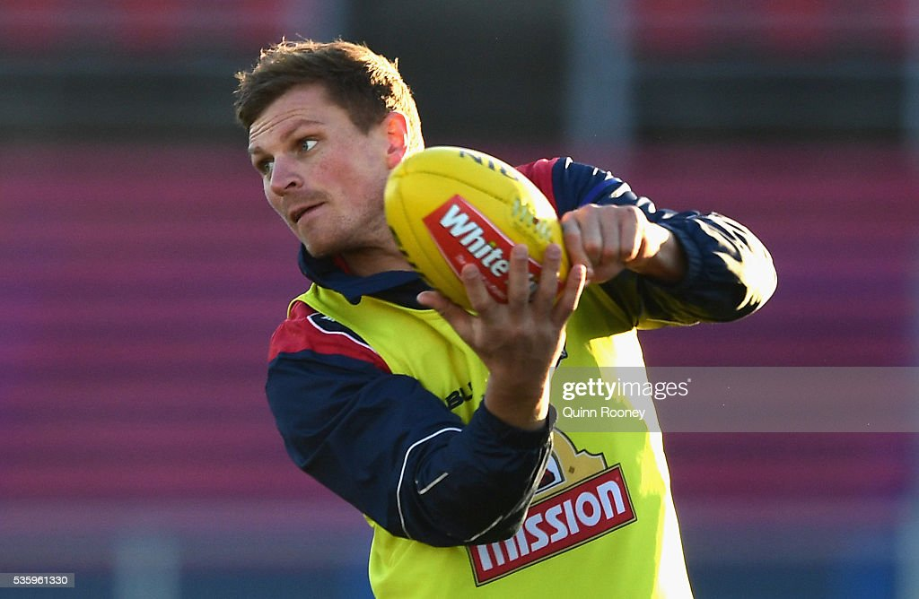 Jack Redpath of the Bulldogs handballs during a Western Bulldogs AFL training session at Whitten Oval on May 31, 2016 in Melbourne, Australia.