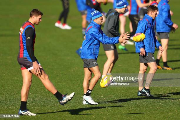 Jack Redpath of the Bulldogs Jason Johannisen of the Bulldogs kick the ball during a Western Bulldogs AFL training session at Whitten Oval on June 23...