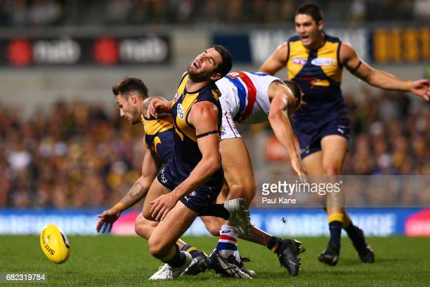 Jack Redpath of the Bulldogs lands a hip and shoulder on Jack Darling of the Eagles during the round eight AFL match between the West Coast Eagles...