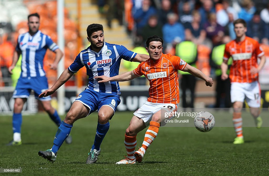 Jack Redshaw of Blackpool holds off Sam Morsy of Wigan Athletic during the Sky Bet League One match between Blackpool and Wigan Athletic at Bloomfield Road on April 30, 2016 in Blackpool, England.