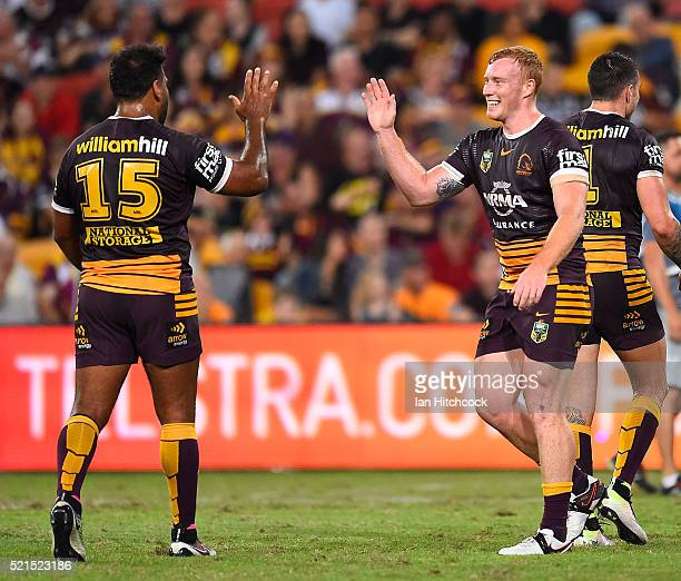 Jack Reed and Sam Thaiday of the Broncos celebrater the try of Anthony Milford of the Broncos during the round seven NRL match between the Brisbane...