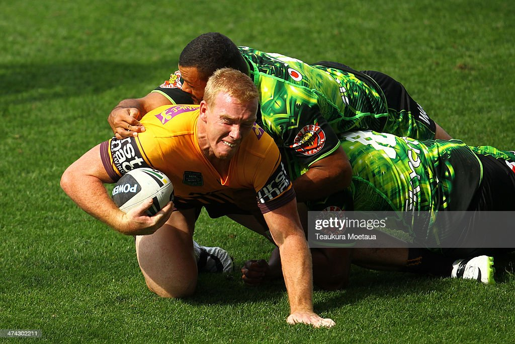 Jack Reed of the Brisbane Broncos is tackled during the NRL trial match between the Brisbane Broncos and the New Zealand Warriors at Forsyth Barr Stadium on February 23, 2014 in Dunedin, New Zealand.