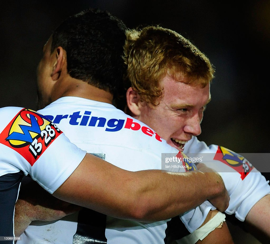 Jack Reed (r) of the Broncos congratulates Josh Hoffman after he scored a try during the round 23 NRL match between the North Queensland Cowboys and the Brisbane Broncos at Dairy Farmers Stadium on August 12, 2011 in Townsville, Australia.