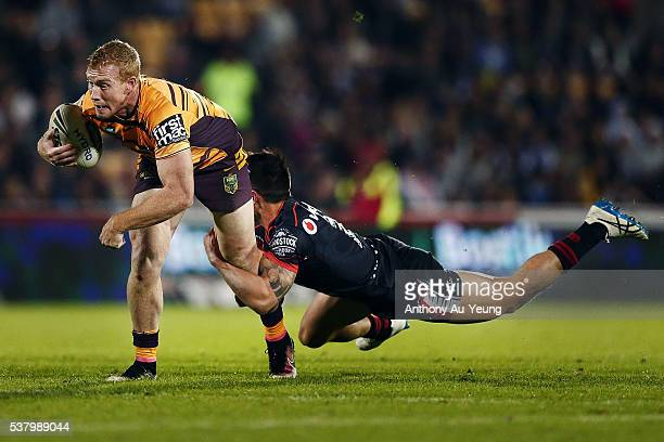 Jack Reed of the Broncos is tackled by Shaun Johnson of the Warriors during the round 13 NRL match between the New Zealand Warriors and the Brisbane...