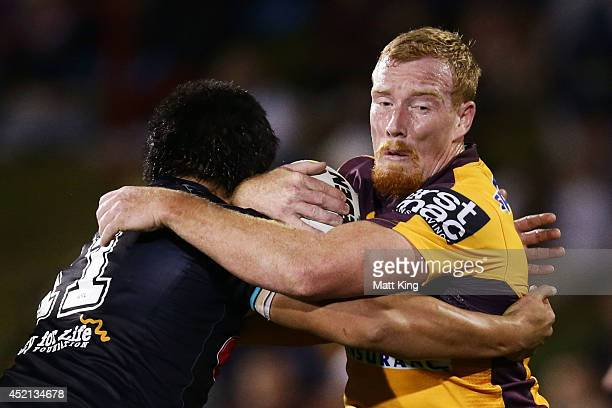 Jack Reed of the Broncos is tackled during the round 18 NRL match between the Penrith Panthers and the Brisbane Broncos at Sportingbet Stadium on...