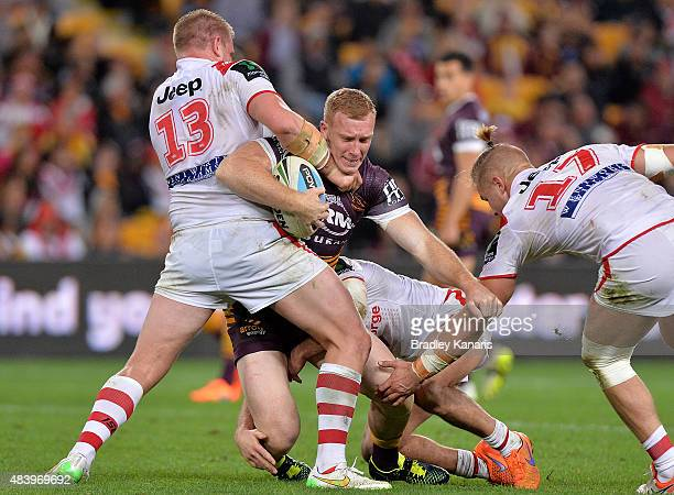 Jack Reed of the Broncos is tackled during the round 23 NRL match between the Brisbane Broncos and the St George Illawarra Dragons at Suncorp Stadium...