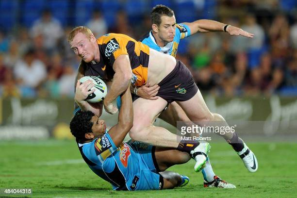 Jack Reed of the Broncos is tackled during the round 6 NRL match between the Gold Coast Titans and the Brisbane Broncos at Cbus Super Stadium on...