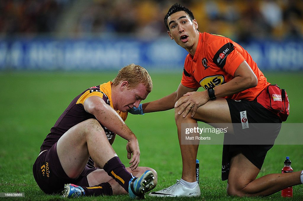 Jack Reed of the Broncos receives attention on the field during the round 10 NRL match between the Brisbane Broncos and the Gold Coast Titans at Suncorp Stadium on May 17, 2013 in Brisbane, Australia.