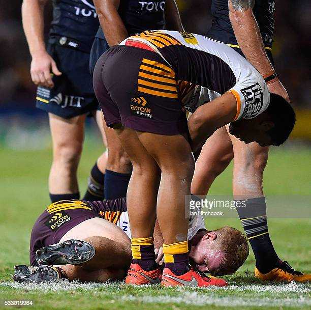 Jack Reed of the Broncos recieves treatment after being injured during the round 11 NRL match between the North Queensland Cowboys and the Brisbane...